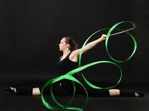 Beautiful gymnast with green ribbon Stock Photo