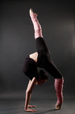 Beautiful gymnastic pose. Young woman showing beautiful gymnastic pose Stock Photos