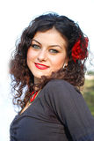 Beautiful Gypsy Girl. A curly hair girl ehjoying in the gypsy'd day party and looking so fashionable Stock Photo
