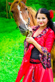 Beautiful gypsy girl with a horse Royalty Free Stock Photos