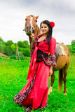 Beautiful gypsy girl with a horse Stock Photography