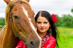 Beautiful gypsy girl with a horse Royalty Free Stock Photo