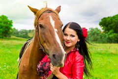 Beautiful gypsy girl with a horse Stock Images