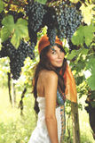 Beautiful gypsy girl poses in a vineyard Royalty Free Stock Photo