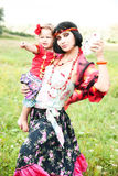 Beautiful gypsy girl in a red dress with the baby Stock Images
