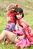Beautiful gypsy girl in a red dress with the baby Royalty Free Stock Photos