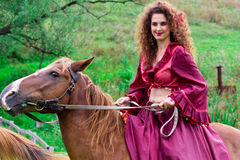 Beautiful gypsy girl riding a horse Stock Images