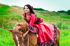 Beautiful gypsy girl riding a horse Royalty Free Stock Photos