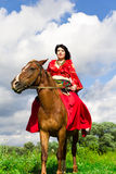 Beautiful gypsy girl riding a horse Royalty Free Stock Photography