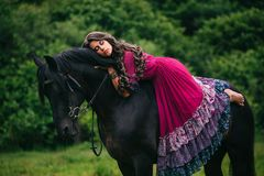 Beautiful gypsy in violet dress Royalty Free Stock Image