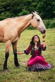 Beautiful gypsy in violet dress Stock Photos