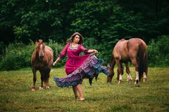 Beautiful gypsy in violet dress Royalty Free Stock Photography