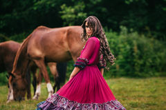 Beautiful gypsy in violet dress stock image