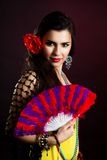 Beautiful gypsy woman with fan Stock Photo
