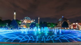 Beautiful Hagia Sophia in Istanbul old town timelapse with blue illuminated fountain, Sultanahmet district, Turkey stock video footage