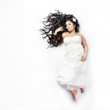 Beautiful hair. Portrait of young beautiful woman with extra long glossy hair Royalty Free Stock Images