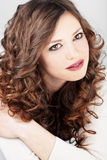 Beautiful hair. Portrait of young beautiful woman with long curly volume hair Stock Images