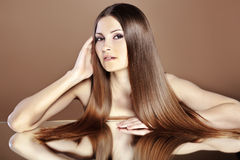 Beautiful hair. Portrait of young beautiful woman with long glossy hair Royalty Free Stock Image