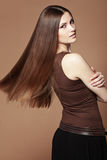 Beautiful hair. Portrait of young beautiful woman with long glossy hair Stock Image