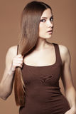 Beautiful hair. Portrait of young beautiful woman with long glossy hair Stock Images