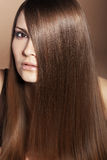 Beautiful hair. Portrait of young beautiful woman with long glossy hair Stock Photo