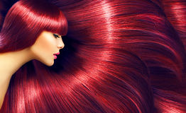 Beautiful hair. Beauty brunette woman with long straight red hair stock photo