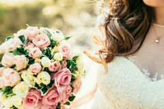 Beautiful hair of bride holding wedding bouquet Stock Image