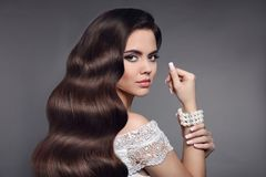 Beautiful hair. Brunette girl portrait. Beauty makeup. Long heal Stock Photos