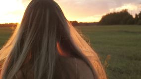 Beautiful hair girl at sunset stock footage