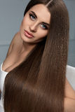 Beautiful Hair. Woman Model With Glossy Straight Long Hair. Stock Photo