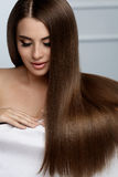 Beautiful Hair. Woman Model With Glossy Straight Long Hair Royalty Free Stock Photo