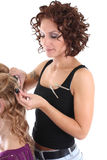 Beautiful hairdresser with client over white Stock Photography