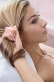Beautiful hairstyle. Young woman and her beautiful hairstyle stock photography