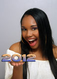 Beautiful Haitian Girl Holds 2012 Stock Images