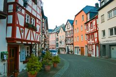 Beautiful half timbered fachwerk house. Street with a Beautiful half timbered fachwerk houses in Germany in spring. outdoors travel. bernkastel kues stock photography
