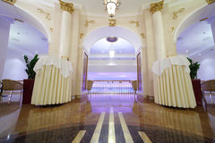 Beautiful hall with columns in Hotel Ukraine. MOSCOW - APRIL 27: Beautiful light hall with white columns in Hotel Ukraine, on April 27, 2011 in Moscow, Russia Stock Image