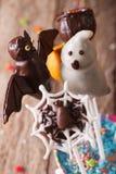 Beautiful Halloween cake pop in a bucket macro. vertical Royalty Free Stock Photography
