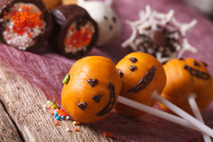 Beautiful Halloween cake pop pumpkin jack macro. horizontal Royalty Free Stock Image