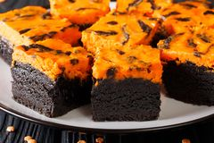 Beautiful Halloween food: sweet dark brownie cake decorated with stock images