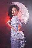 Beautiful Halloween vampire woman aristocrat with lace-parasol Royalty Free Stock Photos