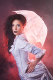 Beautiful Halloween vampire woman aristocrat with lace-parasol Royalty Free Stock Image