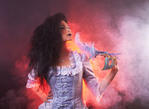 Beautiful Halloween vampire woman aristocrat with venetian mask Stock Photo