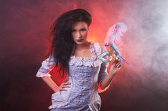 Beautiful Halloween vampire woman aristocrat with venetian mask. On black background Royalty Free Stock Photos