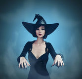 Beautiful Halloween witch royalty free stock photography