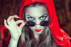 Beautiful halloween woman in black glasses Royalty Free Stock Photography