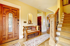Beautiful hallway with rustic and wicker storage seat Stock Image