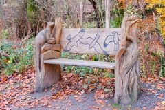 Beautiful Hand Carved Bench Depicting Birds and Animals in Lochwinnoch Scotland. royalty free stock photo