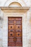 Majestic wooden door in Pienza, Italy. stock images