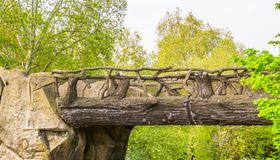 Beautiful hand crafted wooden bridge made out of tree trunks and branches, fairytale scenery, garden architecture, nature. A beautiful hand crafted wooden bridge stock images