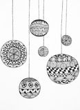 Beautiful hand drawn christmas globes. Hand drawn illustration of black and white ornaments on white paper Royalty Free Stock Image